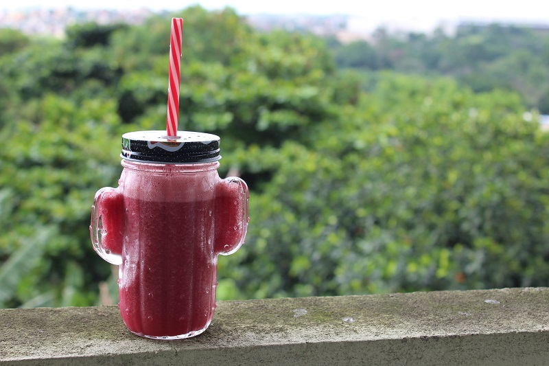 Smoothies on a Banister with Trees in the Background