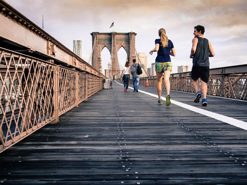 Weight Loss Man and Woman Running on Bridge