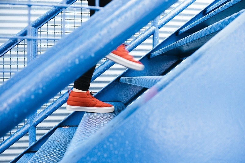 Tips to Reach Your Goals Close Up of Someone Walking Up Stairs