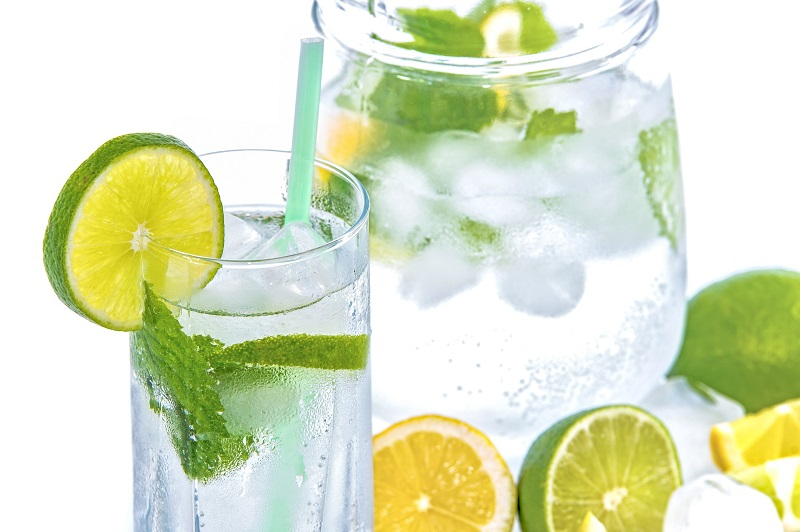 Reasons Why Fad Diets Are Dangerous For You View of a Glass of Water with Lemon and Lime Slices
