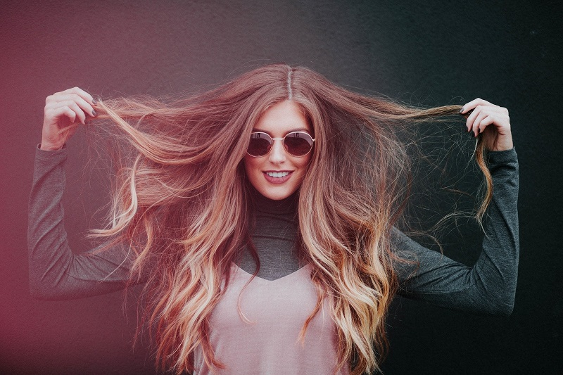 Tips To Stop Anxiety In Its Tracks for Adults Woman Holding Her Hair Out