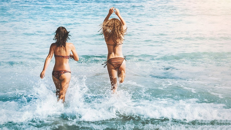 How to Get More Energy Women Running into the Ocean