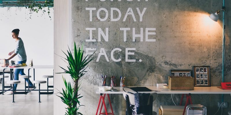 "Motivational Quotes for Healthy Living ""Punch today in the Face"" Written on a Wall in a Store"