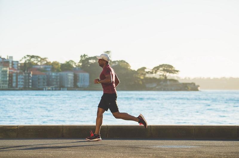 Cardio Workouts to Burn Fat Man Running Along The Coast