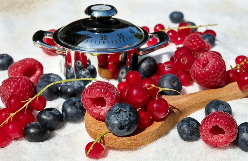 Complex vs Simple Carbs Assorted Berries on a Wooden Spoon
