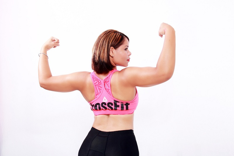 10 Minute Workouts Woman Flexing Her Arms