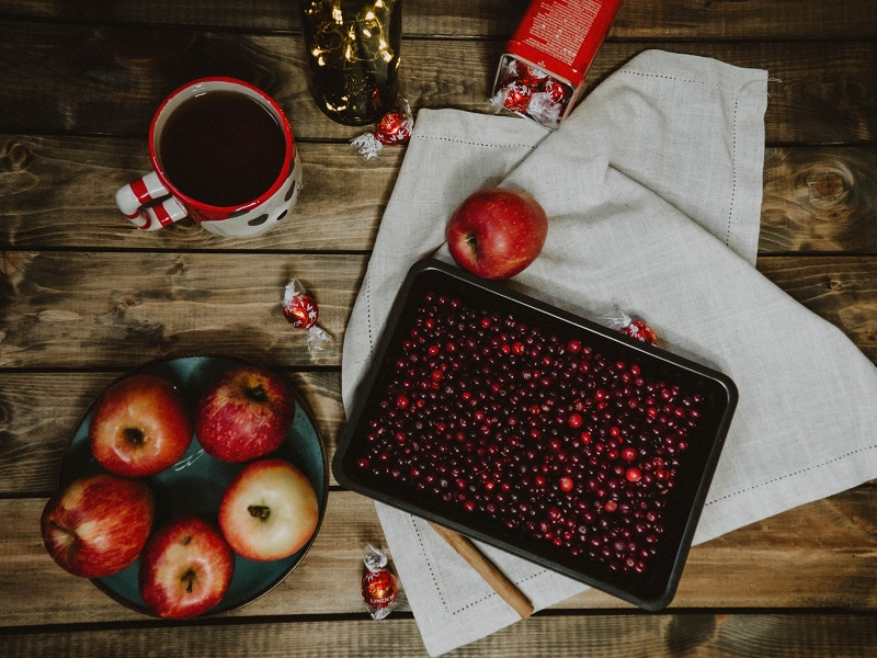 Cranberry Tea Recipes Cranberries on a Tray Surrounded by Apples and Drinks