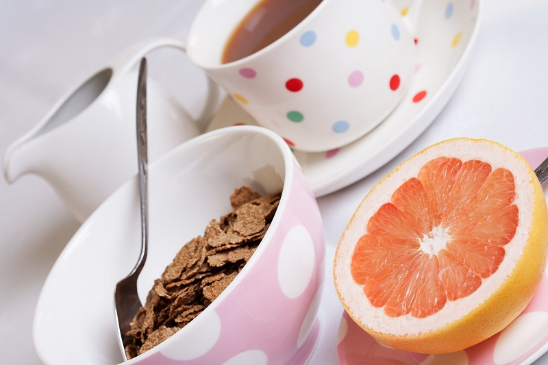 Herbalife Digestive Health Products A Bowl of Fiber Cereal with a Grapefruit Half Next to it