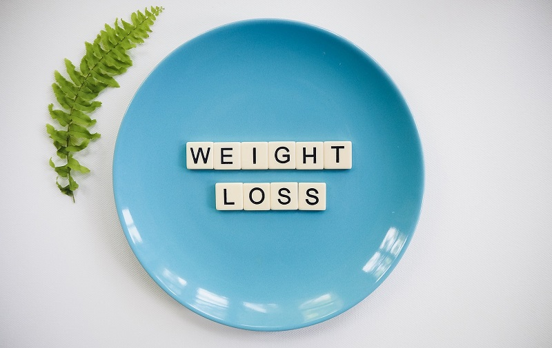 Herbalife Healthy Weight Products a Plate With Letter Tiles That Spell Out Weight Loss