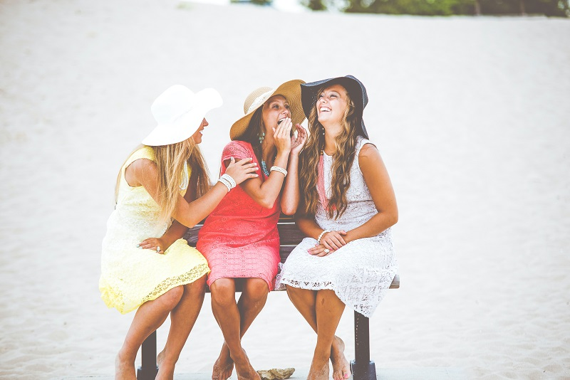 Herbalife Immune Health Benefits Three Women Wearing Summer Clothing Sitting on a Bench Laughing Together