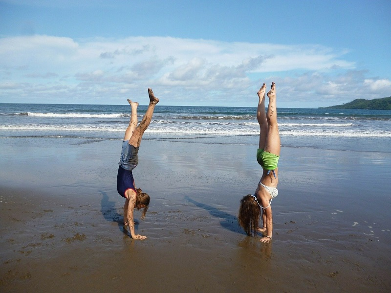 Herbalife Immune Health Products Two People Doing Handstand on a Beach