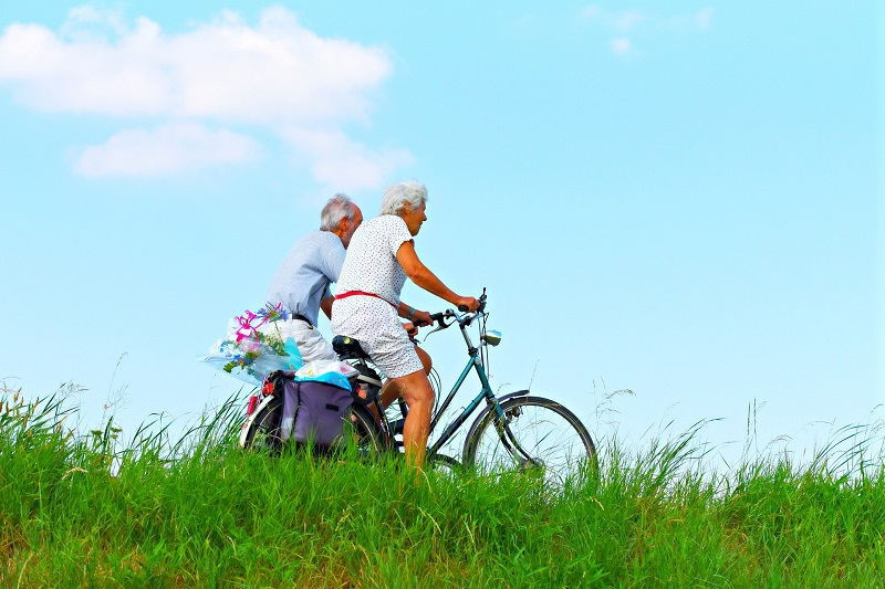 Herbalife Immune Health Products Two Older People Riding Bikes Through a Field