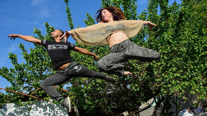 Herbalife Immune Health Products Man and WOman Jumping Through the Air