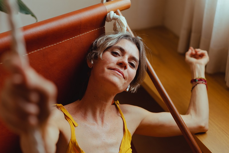 Herbalife Healthy Aging Product Benefits Woman Lounging in a Hammock