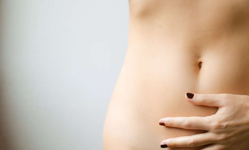 Herbalife Healthy Aging Products Woman with Her Hand on Her Stomach