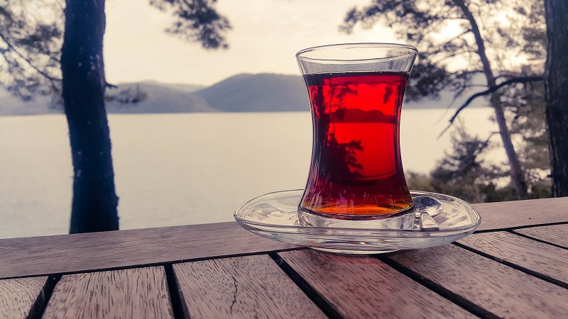 Herbalife Healthy Weight Product Benefits A Pitcher of Tea on a Wooden Table in Front of a Lake