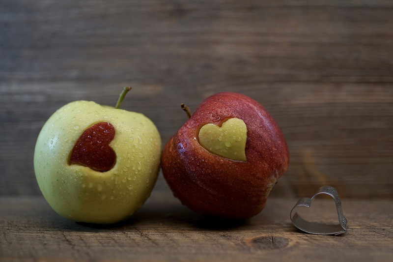 Herbalife Heart Health Products Two Apples with Hearts Cut Out of Each One