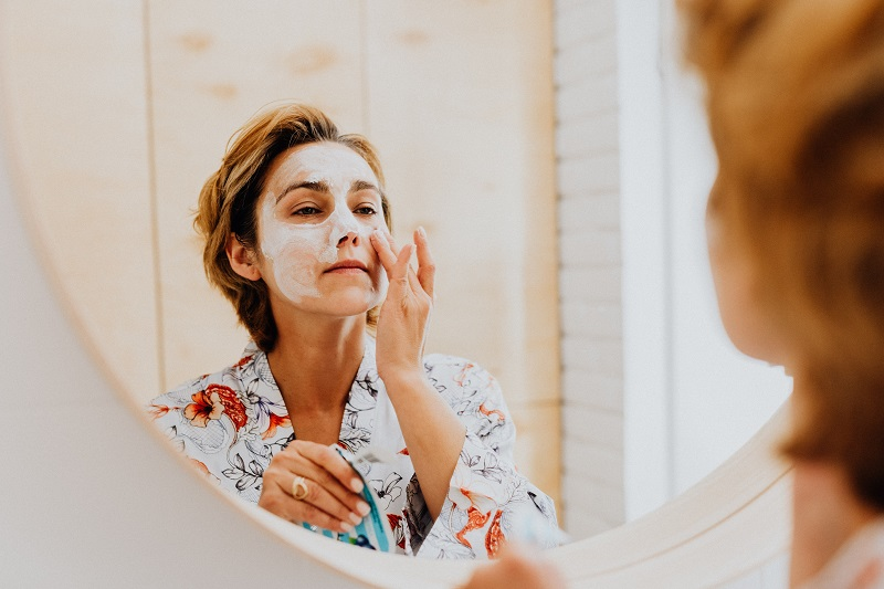 Herbalife Healthy Aging Product Benefits Woman Putting Cream on Her Face