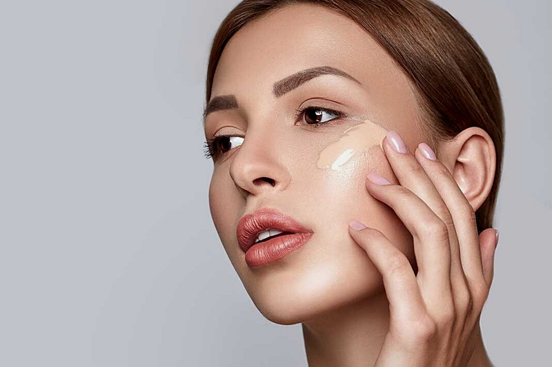 Benefits of Aloe in your Beauty Routine Woman with a Streak of Concealer on Her Cheek