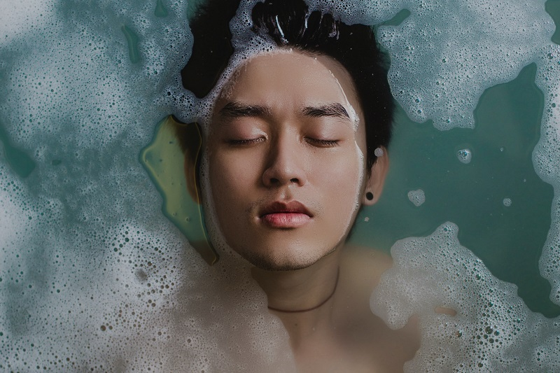 Herbalife Skin Products for Dark Spots Overhead View of a Man in a Bath Filled with Water