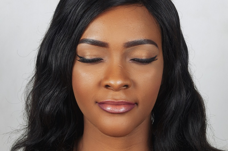 Herbalife Skin Products Woman with Her Eyes Closed Facing the Camera