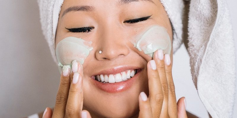Herbalife Skin Product Benefits Woman Rubbing Cream on Her Cheeks